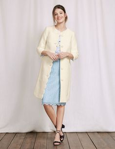 We've tailored luxurious, textured fabric into this wear-with-anything coat. The scalloped edge and elegant lining add a feminine touch, and its pockets mean it's practical too. The crew-neck shape is ideal for wearing over dresses – or pair it with jeans for a more casual look.