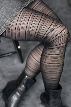 Scrolled and patterned stripes of black banded between sheer for a striking, yet delicate, combination we love.  Boy-short style panty area is semi-opaque, striping goes down the legs all the way to the toes.