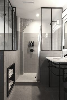 Love the idea of using real steel windows in the shower instead of custom glass shower glass without a frame  Ace Hotel Los Angeles Steal This Look/Remodelista