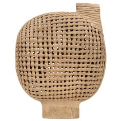 Unknown Artist. Interwoven Stoneware Vessel United States 1980's. A superb hand crafted vessel composed of basket woven strips of stoneware, with an oval neck and raised on an tall oval foot. American, circa 1980.