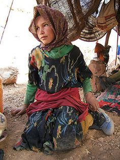 Language: In this picture you see a young Berber girl under a tent in Morocco. I believe Berber is also a  Moroccan tribe located in the North. 40% of the people of Morocco are Berber and speak it as well. There are also different types of Berber, kinda like how there's different kinds of English.
