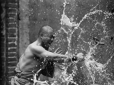 Monks fighting kung-fu at Shaolin temple. Photo by Tomasz Lewandowski