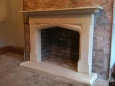 Tudor arch Fireplace -- Richard A. Mossman Stonemasonry