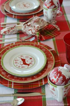 Christmas table with red and green plaid and Pfaltzgraff Dancing Snowflakes | homeiswheretheboatis.net #tablescape