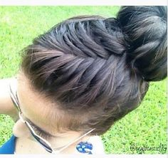 French fishtail braid into bun. I'd never be able to do it but love the way it looks!