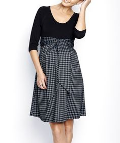 Flaunt that bump with style and grace. Darling details—including a classic houndstooth print and adjustable tie-waist under the bust for a snug fit—make this dress unforgettable, while an A-line skirt lends a relaxed silhouette.  Measurements (size S): 37.5'' long from high point of shoulder to hem47% polyester / 26% rayon / 22% nylon / 5% spandex