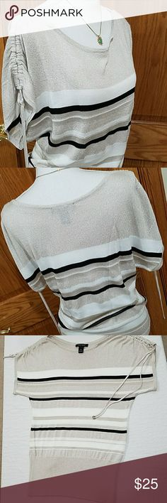 "NWOT White House Black Market Pullstring Knit Lighter side of your fabrics in an oversized loose fit. Shoulder down sleeves that have a pullstring for a ruched look. Wide bottom hem and a glitter throughout the tan thats hardvto capture but sparkles. White, tan, and black with varying levels of sheerness / fabric weight. Breastline 18.5"" length 29.5"" from shoulders down. Bottom hem across 15"". Shoulder coverage from neck to end of sleeve 7-8ish inches depending on how much you tighten. See…"