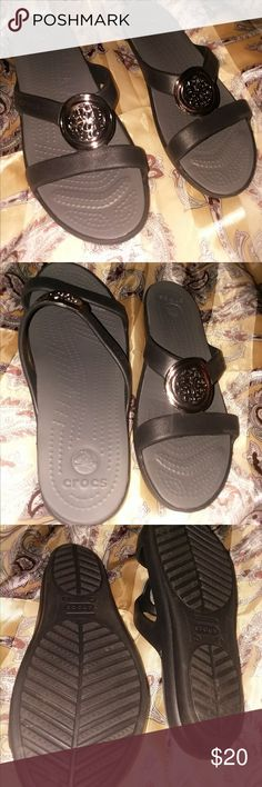 CROCS NEW CONDITION Black with grey inside with a gold medallion CROCS Shoes Sandals