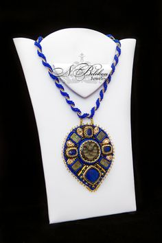 Embroidery bead pendant with a beautiful geode simbirtsite,lapis lazuli,spektropirity and Swarovski crystals. Royal blue,gold and bronze от NadezhdaBelokon