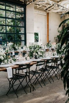 Industrial reception decor with earthy floral design | Image by Nicole Leever