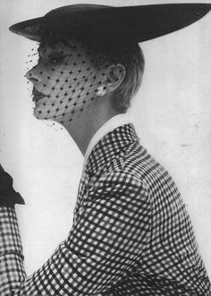 Lisa Fonssagrives wearing a bicorne skimmer by Lilly Daché for  Vogue, 1950. Photo: Irving Penn.