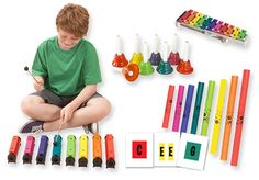 """RING & BOOM Set - RING & BOOM Set includes:  Resonator Bells with 8 mallets and carrying case. Chroma- Notes Handbells Sonor Glockenspiel Includes F# & B bars and 2 mallets. 12"""" x 4"""" Diatonic Boomwhackers Boomwhacker & Bells Flashcards by Mary Ann Stewart."""