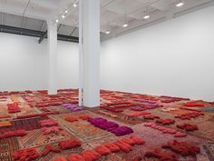 lin tianmiao weaves words about women into a carpet landscape at galerie lelong textiles and thread.