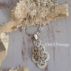 """Vintage White Rhinestone Necklace I found this amazing chippy white metal necklace and added this absolutely gorgeous vintage rhinestone piece. A one of a kind statement piece. Pendant measures 3.5"""" long. Chain is 30"""". ChicEVintage Jewelry Necklaces"""