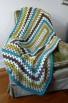Ravelry: Granny Blanket pattern by Bernat Design Studio-free pattern.  This would be pretty in burgundy and tan, or neutral colors for a nice gift.