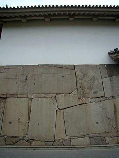 Osaka Castle's massive stone walls...