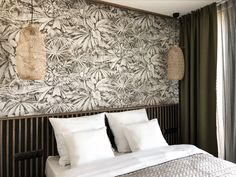 bedroom | floral wallpaper | bamboo lamp |  bed headboard