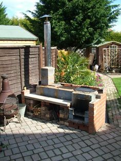 outdoor kitchen with rocket stoves & oven