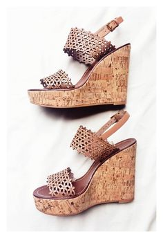 Tory Burch daisy wedges. Love the daisy part, but need less wedge