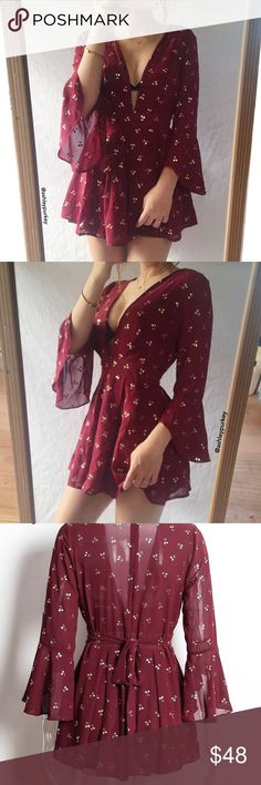 Maroon and gold cherry V plunge bell sleeve romper •size: S   •features: bell sleeve, plunge V front, zipper and tie in the back   •no trades  ⚠️ if this item does not fit you CANNOT return it - poshmark policy B-Long Boutique  Dresses Mini