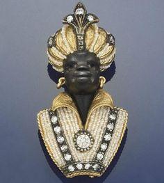 A diamond, onyx and seed pearl blackamoor brooch