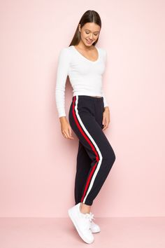 Zari Sweatpants Description: Soft jersey cotton sweatpants in navy blue with red and white stripe side detailing, elastic waistband and cuffs. Fabrics: cotton, polyester Measurements: rise, inseam, waist (stretch) Made in: China 6th Form Outfits, Uni Outfits, Cute Lazy Outfits, Basic Outfits, Outfits For Teens, Winter Outfits, Cool Outfits, Fashion Outfits, Fashion Ideas