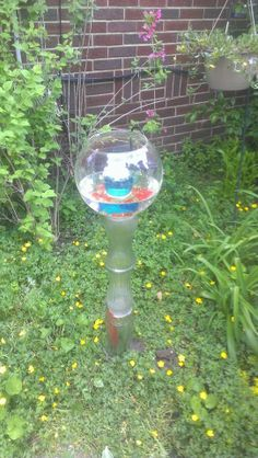 birdbath made from recycled vases and glass bowl.  I added stone in the center for color and a colored glass upside down so the birds have somewhere to perch