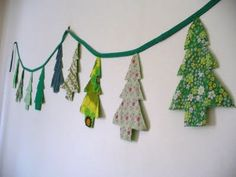 It's time to raid your stash of fabric scraps because this Sweet and Simple Christmas Tree Bunting is too cute to pass up! Choose your favorite patterned fabrics and turn them into homemade Christmas decorations that are uniquely you! Christmas Makes, Noel Christmas, Homemade Christmas, Simple Christmas, Christmas Ideas, Fabric Christmas Trees, Christmas Tree Garland, Xmas Trees, Christmas Banners