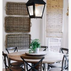 Breakfast room with textural basket trays on wall & large-scaled lantern - James Farmer