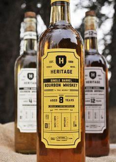 "Heritage  Designed by Katelyn Peissig | Country: United States  ""Heritage is a brand of single barrel bourbon whiskey who's packaging reflects the age-old process of true whisky making. The creation of Heritage Single Barrel Bourbon Whiskey starts out with natural spring water and American born corn that is placed in a copper still to be distilled. From there its placed in charred oak barrels to age and gain color and flavor from the wood. Once the barrels have aged, the Bourb"
