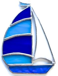 Check out this item in my Etsy shop https://www.etsy.com/uk/listing/464436196/blue-sailboat-stained-glass-suncatcher