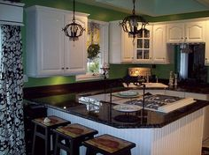 My painted formica countertops to resemble granite!  Yes they were once hunter green with wood trim!  Yuck!