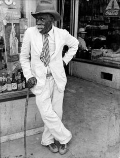 An old African-American man wearing a disheveled outfit. Photograph by Alfred Eisenstaedt. Southern United States, 1938.