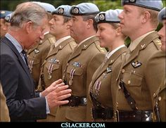 Charles was presenting service medals to 44 soldiers from nine regiment of the Army Air Corps at Clarence House when he was caught in the embarrassing pose.