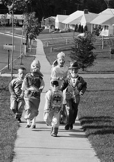 trick or treaters in suburbia vintage Halloween photo.  Notice no parents walking along.