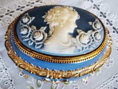 Blue trinket box with white cameo