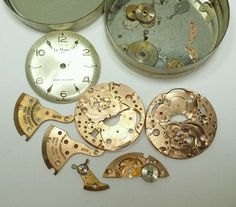 Vintage mens Le Marc mechanical watch movement lot in tin #14F