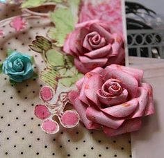 Easy paper rose tutorial...    http://stacycohen.blogspot.com/2010/08/prima-layout-and-paper-rose-flower.html