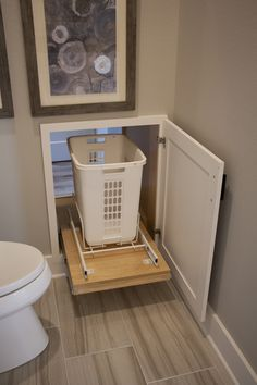 Work smarter, not harder with this laundry pass through from the master bath to the laundry room!Laundry Pass Through Laundry Chute, Laundry Room Doors, Laundry Room Shelves, Laundry Room Remodel, Laundry Decor, Farmhouse Laundry Room, Small Laundry Rooms, Laundry Closet, Laundry Room Organization