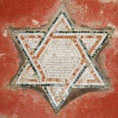 On a wall in the Jewish Quarter of Rome. The Jewish presence in Italy dates to the pre‑Christian Roman period and has continued, despite periods of extreme persecution and expulsions from time to time, until the present. As of 2007, the estimated core Jewish population in Italy numbers around 28,500.