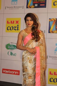 Priyanka Chopra kept it sober and simple in a traditional paper silk saree with gold sequins at Zee Cine Awards 2014.