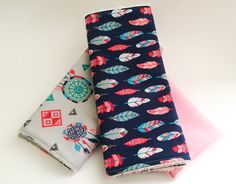A personal favorite from my Etsy shop https://www.etsy.com/listing/294212829/feather-themed-burp-cloth-set