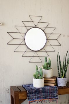 Bring the Southwest to your home with this raw metal mirror. Its geometric…