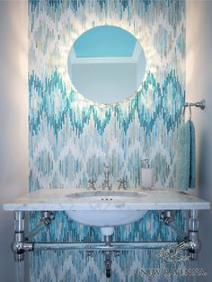 Loom, a handmade jewel glass mosaic shown in Quartz, Aquamarine, Tanzanite and Turquoise, is part of the Ikat Collection by Sara Baldwin for New Ravenna Mosaics.