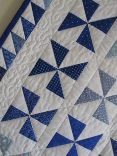 Pinwheel quilt detail - I like the triangle boarder