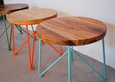 Wood stool with colorful powder coated legs.