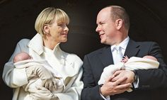 Proud parents: Princess Charlene and Prince Albert smile at each other as they show their twins off to the world for the first time   1/7/2015