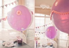 wind themed hot air balloon cotton candy birthday party pink hot air balloons with DIY banner made of scrapbook paper