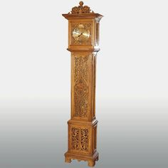 A very ambitious and unusual antique German pierced fretwork oak tall case clock, circa 1890. This clock is very artistic with delicately cut fretwork panels on front and sides, from top to bottom. We have never had a case like this to offer before and consider it a great opportunity to own a distinctive clock for relatively little money. The movement is a 2 weight chain pull up with hour and half hour strike on a heavy, deep and resonant gong. No warranty.
