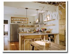Love this modern & rustic looking kitchen!